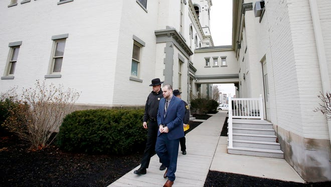Murder suspect Lawrence Baker is escorted from the Chemung County Courthouse Thursday after the prosecution rested its case. Baker admitted to shooting Najee Holmes on Feb. 13, but his actions were done in self-defense.