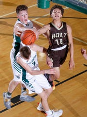 Holt's Caleb Cooper, right, collides with Williamston's