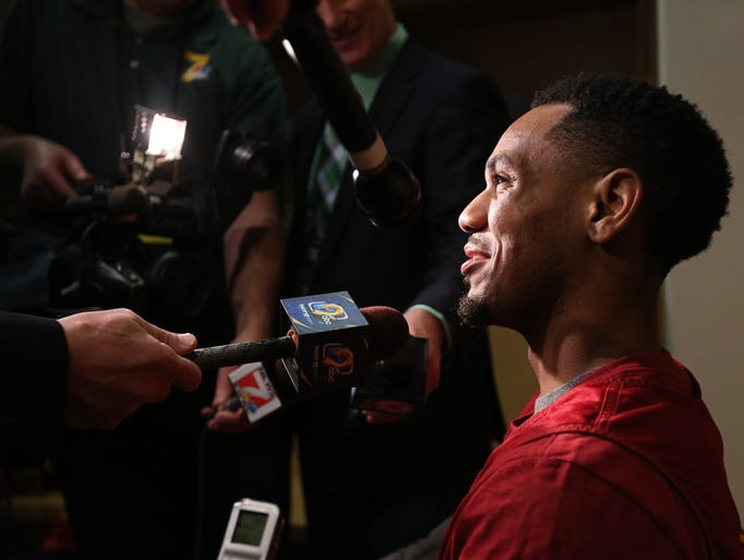 Iowa State's Monte Morris talks to the media before