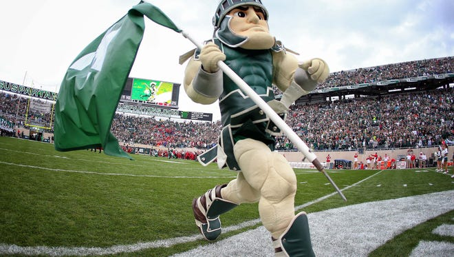 Sparty takes the field prior to a game against the Indiana Hoosiers at Spartan Stadium.