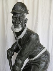 """A sculpture by artist Peter Rujuwa titled """"Miner"""" at the Haan Mansion Museum Friday, May 13, 2016, in Lafayette."""