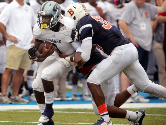 Chalkville's Ty Pigrome runs the ball as Blackman's