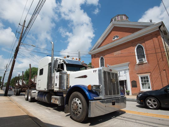 A tractor-trailer travels on East Camden-Wyoming Avenue