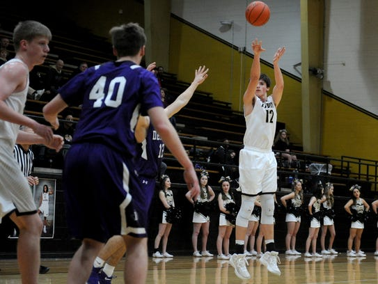 Rider's Ty Caswell shoots from three-point range against