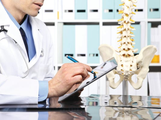 Radiologist doctor with digital tablet checking xray, healthcare, medical and radiology concept