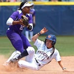 Auburn's Tiffany Howard (1) is forced out at second base by LSU shortstop Bianka Bell (27) in the third inning of a game in the NCAA Women's College World Series softball tournament in Oklahoma City on Thursday.