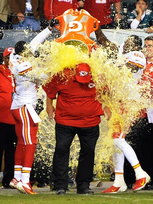 Kansas City Chiefs receiver Donnie Avery (17) and Dwayne Bowie (82) douse coach Andy Reid with a cooler of Gatorade in the final minute of the game against the Philadelphia Eagles at Lincoln Financial Field. The Chiefs defeated the Eagles 26-16.