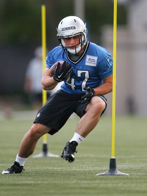 Detroit Lions running back Zach Zenner runs a drill during rookie minicamp in Allen Park on May 8, 2015.