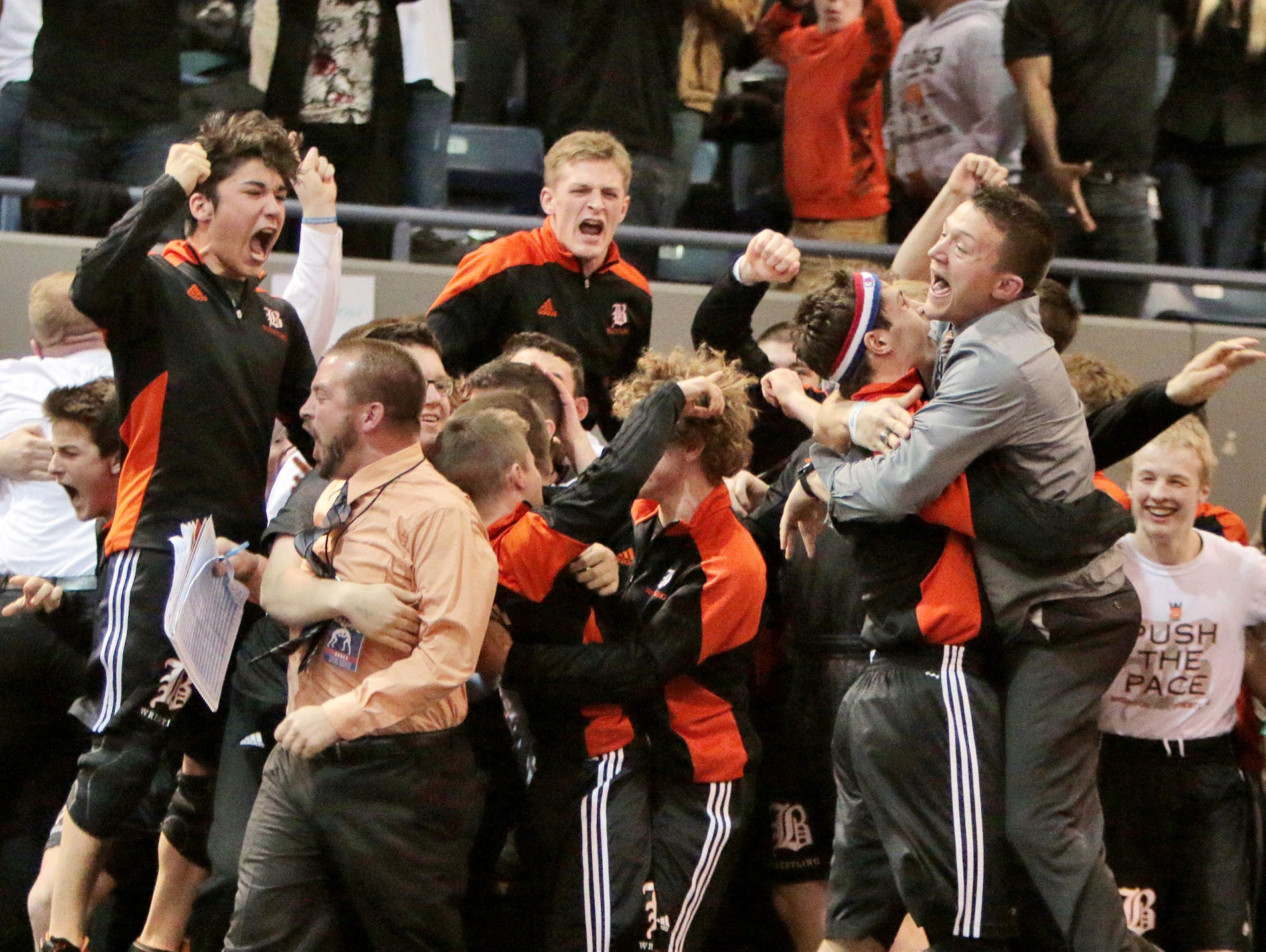 Brighton coaches and players celebrate after they won the first state title in program history.