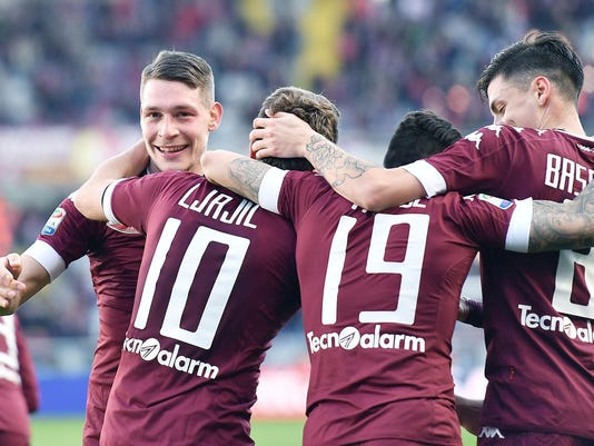 Torino's Andrea Belotti, left, celebrates with his teammates after scoring during a Serie A soccer match between Torino and Palermo at the Turin Olympic stadium, Sunday, March 5, 2017. (Alessandro Di Marco/ANSA via AP)