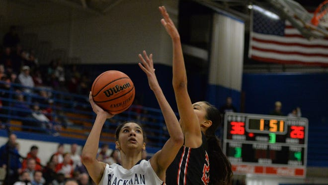 Blackman's Jazz Bond goes up for a shot over Oakland's Maddie Cook in the Lady Blaze's 57-44 win in the District 7-AAA championship at La Vergne High.