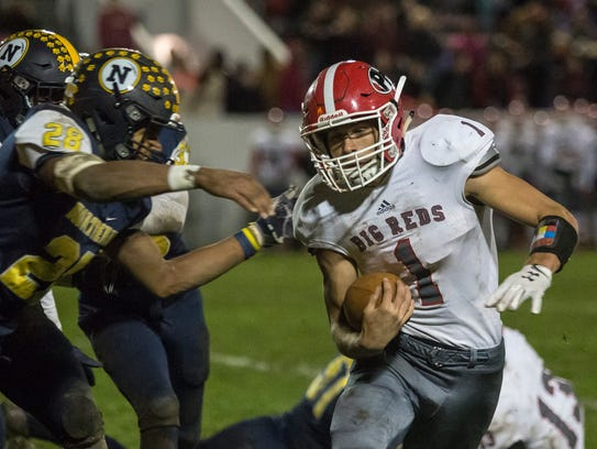 Port Huron's Curtis Corby runs the ball during the