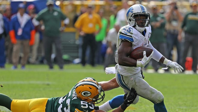 Lions RB Theo Riddick tries to get away from Nick Perry of the Green Bay Packers at Lambeau Field on Sept. 25, 2016 in Green Bay, Wisconsin.