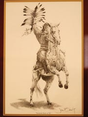 An art print depicting Osceola and Renegade, Florida State University's mascots, adorns the wall of FSU fan Tod Bayne's Fort Myers home.