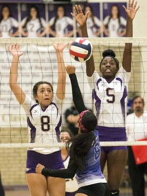 Deandra Allen, 8, and Arielle Mack 5, of Burges rise as Karla Alderete, 6, of Bowie punches the ball over the net Tuesday night at Burges. The Mustangs beat the Bears in three sets.