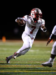 Perth Amboy quarterback Tyler Jack runs for yardage