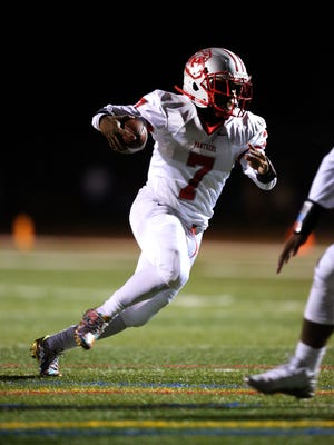 Perth Amboy quarterback Tyler Jack runs for yardage during the first half against J.P. Stevens on Friday, Oct. 13, 2017.