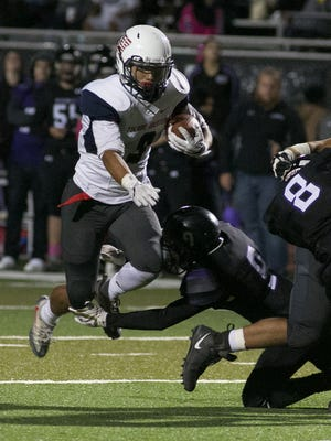 Tulare Western's Damarin Patterson fights for yardage against Mission Oak on Friday night at Bob Mathias Stadium.