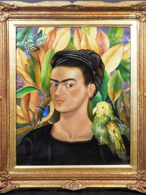 Framed oil on canvas self-portrait done in the modernist style of the iconic Mexican painter  Frida Kahlo (1907-1954), depicting the artist with her signature full brow (est. 15,000-$25,000).