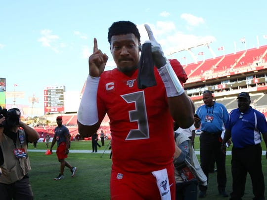 Dec 8, 2019; Tampa, FL, USA;Tampa Bay Buccaneers quarterback Jameis Winston (3) celebrates as he runs off the field after they beat the Indianapolis Colts at Raymond James Stadium. Mandatory Credit: Kim Klement-USA TODAY Sports