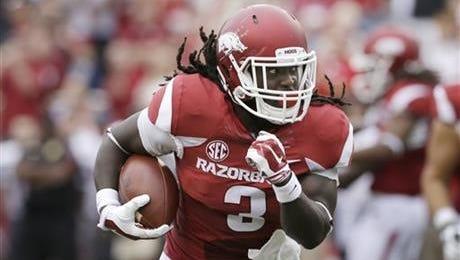 Arkansas running back Alex Collins runs for a touchdown against Nicholls in September.