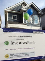 Morris of Habitat for Humanity held a open house dedication of a new home built at 440 Lawrie Street in Perth Amboy. The Mercado family will be moving in to the newly built home.
