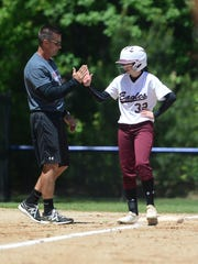 Snow Hill's Tabby Bew gives head coach David Hall a high-five after hitting a triple.