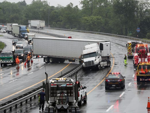 A tractor trailer accident on I-287 near exit 9 in Harrison backed up traffic in both directions for miles June 13, 2014. The truck which was traveling westbound jumped the center guardrail into the eastbound lanes. The trucks saddle tanks ruptured spilling diesel fuel onto the highway and nearby storm drains. The Westchester County Haz-Mat Team was called to the scene.
