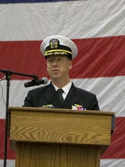 Capt. Kevin Lenox addresses the crowd Thursday as he accepts the command of the USS Nimitz at Naval Base Kitsap-Bremerton.