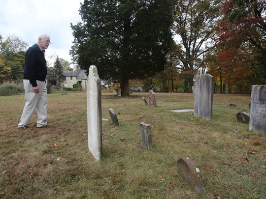 Rye historian Paul Hicks looks at the headstones at Milton Cemetery in Rye Oct. 25 2017. The Landmarks Advisory Committee is seeking city approval to landmark three historic city-owned properties, Milton Cemetery, Purdy Cemetery and Baird Square.