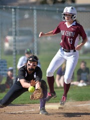 Albany third baseman Josie Fourre catches the ball but not in time to put out Sauk Centre's Kailyn Seidel (13) in the first inning of their South Sub-Section 6-2A final against Sauk Centre on Thursday at River's Edge Park in Waite Park.
