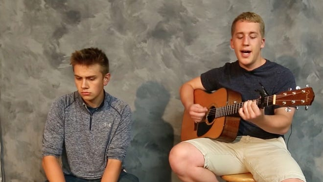 Fond du Lac area musicians Joshua Gui and Eric Reid perform a song at The Fond du Lac Reporter Tuesday October 10, 2017.