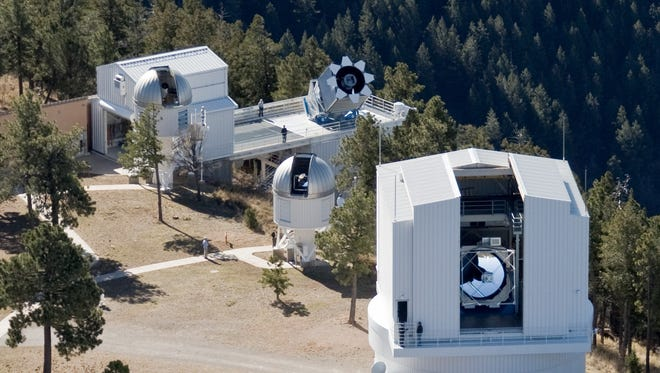 The Apache Point Observatory has received a $16 million grant to continue mapping the entire sky with the Sloan Digital Sky Survey 2.5-meter, the telescope on platform to the right of the large enclosure.