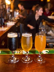 Three of Collective Arts Brewing's beers are seen at The Parlor at The Farmhouse Tap & Grill in Burlington on Friday, November 18, 2016.  Left to right are the Stranger Than Fiction porter, the Saint of Circumstance citrus blonde ale and the Sour Pumpkin saison.