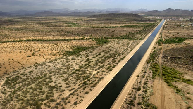 The Central Arizona Project canal cuts through the desert west of Phoenix.