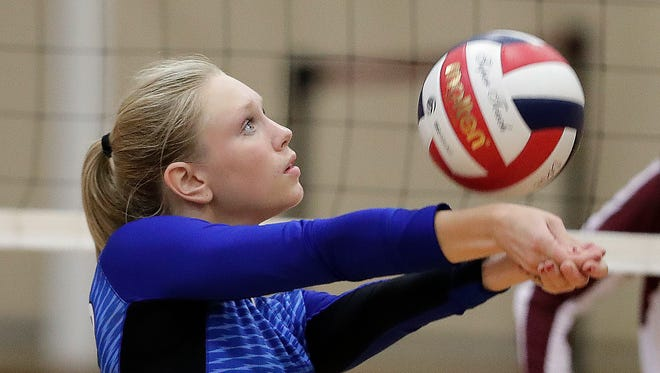 Green Bay Notre Dame's Grace Campbell makes a pass against De Pere on Sept. 22 in a Fox River Classic Conference match. Notre Dame was one of three local teams to receive a top seed for the WIAA playoffs.