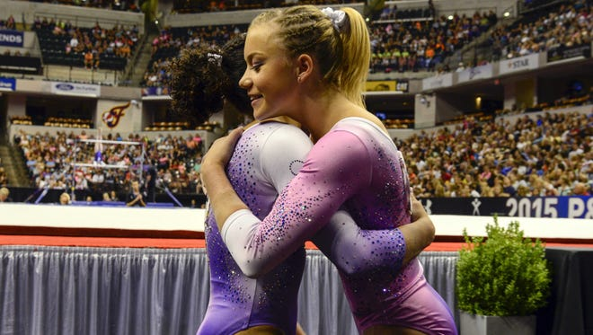 Laurie Hernandez (left) and Jazmyn Foberg hug at the P&G gymnastics championships at Bankers Life Fieldhouse on Saturday, August 15, 2015.