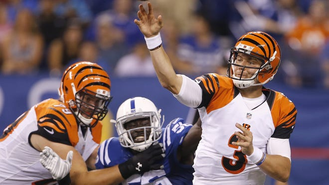 Bengals quarterback Keith Wenning throws under pressure during a preseason NFL game between the Bengals and the Colts on Sept. 3.