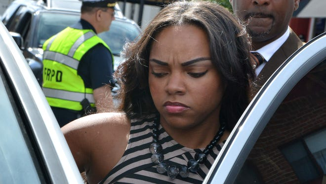 In this  Sept. 6, 2013 photo, Shayanna Jenkins, fiancee of former New England Patriots player Aaron Hernandez gets into her car outside superior court. She has been indicted on a perjury charge.