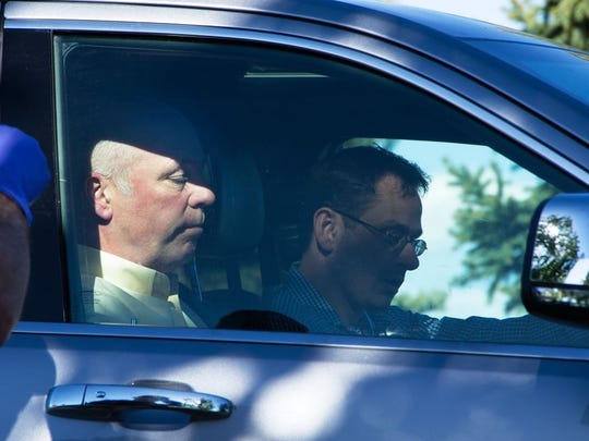Greg Gianforte is seen in a Jeep near a Discovery Drive