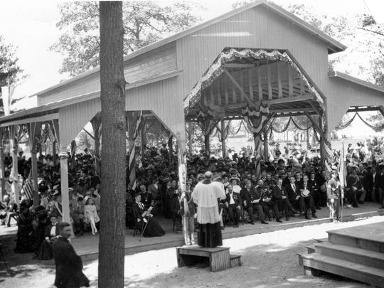 A priest celebrates Mass in 1909 at St. Anne's Shrine during the tercentenary celebration that marked the 300th anniversary of the arrival of Samuel de Champlain.