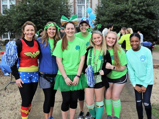 Christy Schrotberger, Celecia Osborne, Angie Durbin, Stormy Battiest, Amanda Terwilliger, Wynter Miller and Amberly Morrow stop for a photo before the beginning of the Undie 5K Run/Walk on Saturday, March 17, 2018 on the Lambuth campus in midtown Jackson.