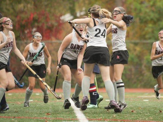Members of the Haddonfield field hockey team celebrate after a goal by Haddonfield's Emma Feldhake, (center, #24) during the first half of Thursday's Central Jersey Group 1 championship.