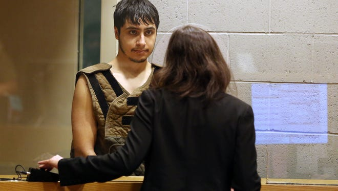Jose Manzur-Roldan, 21, is arraigned on a murder charge Monday, Feb. 8, 2016, at the Marion County Circuit Court Annex in Salem, Ore. He is being charged with murder in connection to his mother's death.