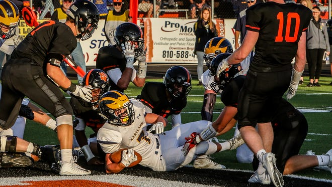 Reece Potter (7) and the Hartland Eagles have an early 6:30 p.m. kickoff Friday at Canton's grass field.