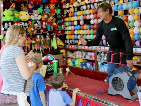 Kids prepare to take their shot at winning prizes at the Manitowoc County Fair in 2016.