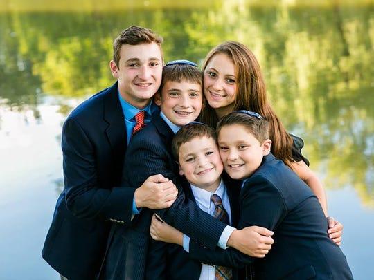Ezra Schwartz and his siblings.