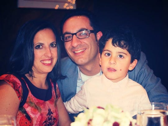 Dr. Rana Awdish with her husband, Randy, and son, Walt.