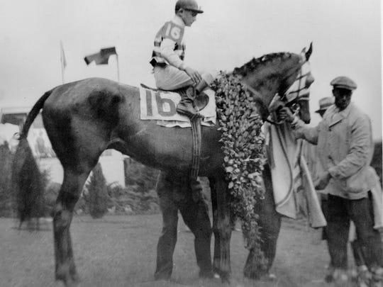 Jockey Don Meade aboard Brokers Tip after winning the 1933 Kentucky Derby.
