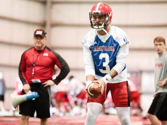 UL coach Mark Hudspeth watches as quarterback Jordan Davis runs a drill during the first day of Cajuns' spring practice Tuesday.